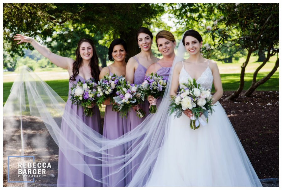 The ladies in lavender with their bouquets by Janssens Market.